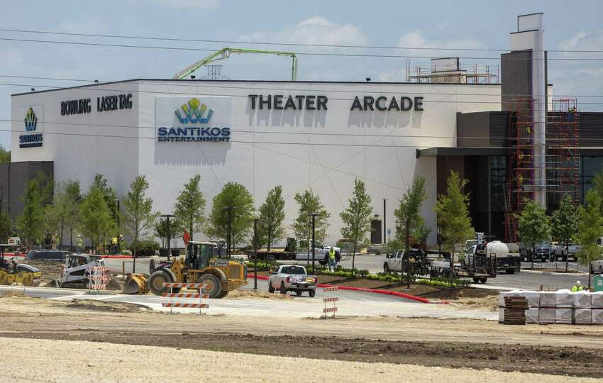 Santikos Cibolo Santikos Entertainment's 87,700-square-foot facility at the Cibolo Crossing development on I-35 opened in spring 2019.. The multiplex includes bowling and laser tag.
