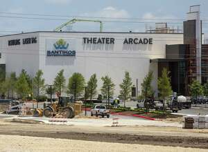 Santikos Entertainment's 87,700-square-foot facility is under construction at the Cibolo Crossing development on I-35. The multiplex, which includes bowling and laser tag, is opening May 23.