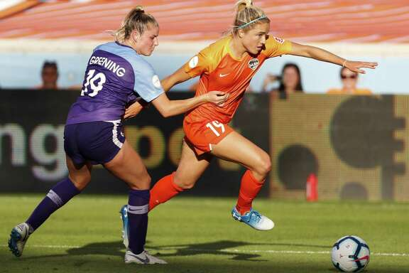 Houston Dash Kristie Mewis (19) and Orlando Pride defender Erin Greening go after a ball near the goal during the second half of a National Women's Soccer League match at BBVA Compass Stadium on Sunday, May 5, 2019, in Houston.
