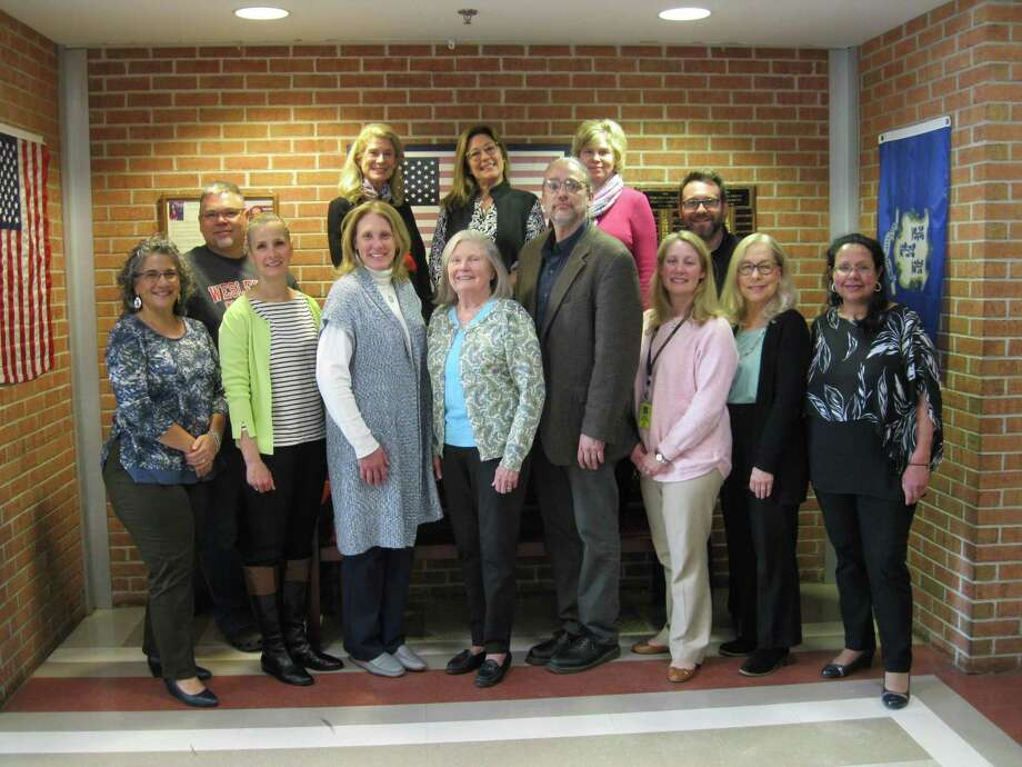 The Community Assets Network Task Force gathers in the lobby of Joel Barlow High School. Task Force members are, front row, left to right: Dr. Gina Pin, Lisa Campeau-Fenzel, Christine Halloran, Anne Kipp, Dr. James Castonguay, Julie McTague, Nancy Doniger, Pamela Gupta; back row, left to right, Chris Angell, Jen Wastrom, Alice Smith, Lynn Zaffino and Tim Huminski. Photo: Contributed Photo / Contributed / The News-Times Contributed