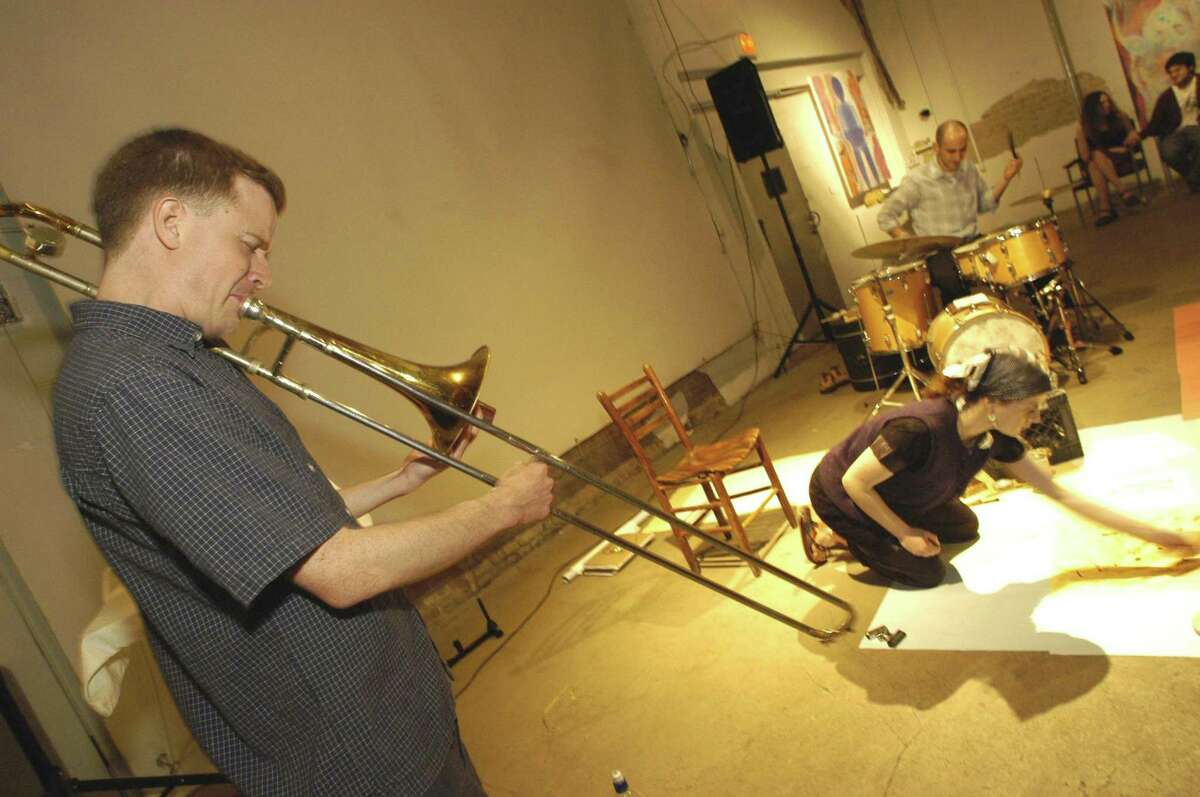 Trombonist Dave Dove performs with other musicians and artists in 2003 in a performance , kicking off an improvisational concert series sponsored by the Pauline Oliveros Foundation.