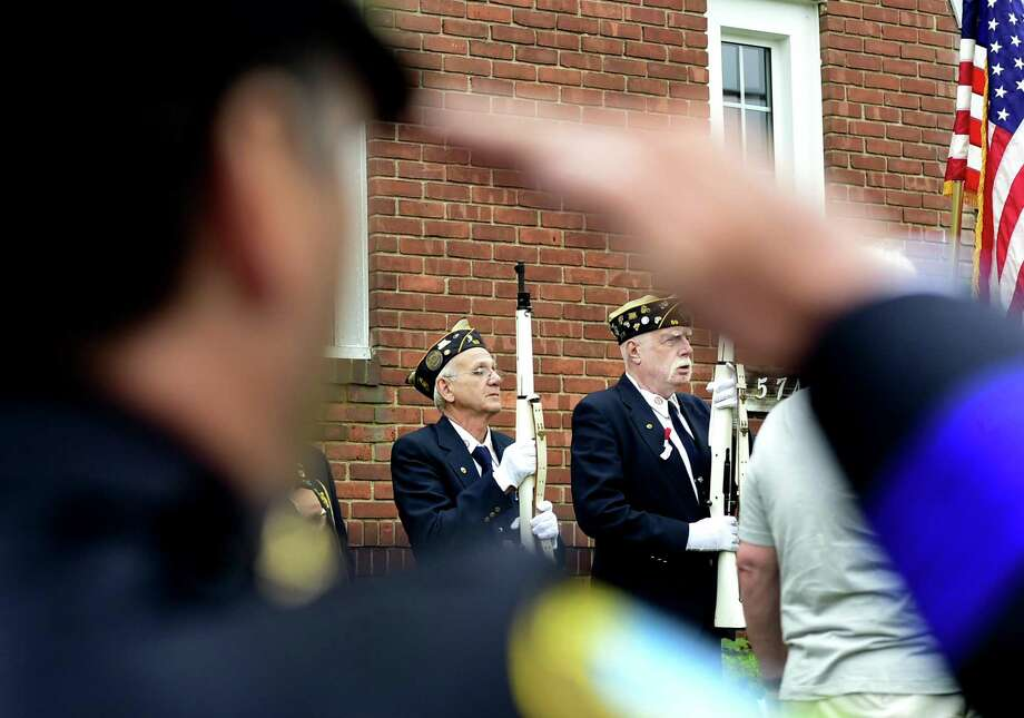 Navy veteran Edward Jackowicz of East Haven, left, and Marine Corps veteran James Comiskey of East Haven, right, stand as honor guards during the 2017 East Haven Memorial Day Ceremony. Photo: Peter Hvizdak / Hearst Connecticut Media File