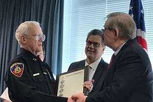 911 Dispatch Center Capt. Greg Tomlin recieving a city proclamation celebrating the work dispatchers do by 911 Communications Director Joe Gaudett and Mayor David Martin.