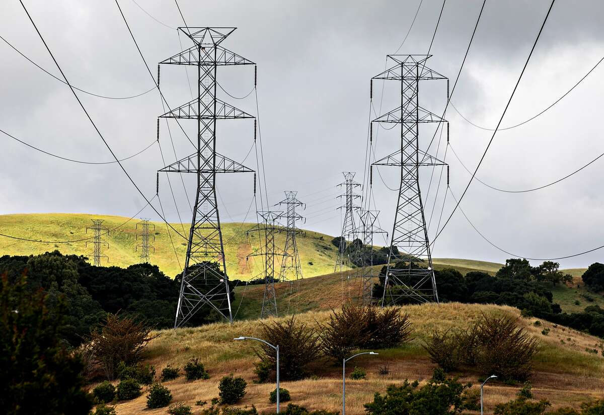 High-voltage power transmission lines owned by PG&E are seen stretched across a neighborhood in western San Ramon, Calif. Friday, May 17, 2019.