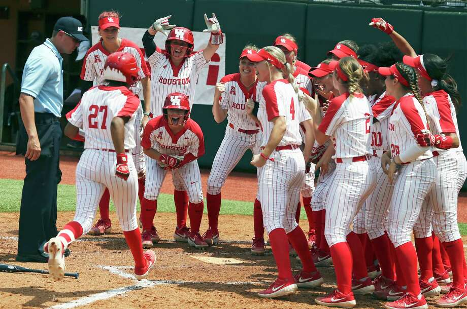 Cougar teammates celebrate at the plate after Arielle James watches her three run homer clear the left field fence as Houston beats Texas A&M 3-1 in the NCAA regional tournament at MCCombs Field in Austin on May 17, 2019. Photo: Tom Reel, Staff Photographer / 2019 SAN ANTONIO EXPRESS-NEWS