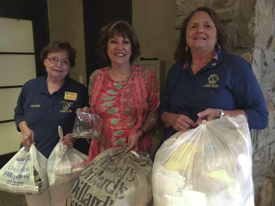 Lake Conroe Centennial Lions Club members donate items every month to be recycled or re-purposed to help save the environment. Pictured here with some items that were donated at the last meeting are, left to right, Lions Dian Dodd, Katherine Maher and Debbie Wilson.