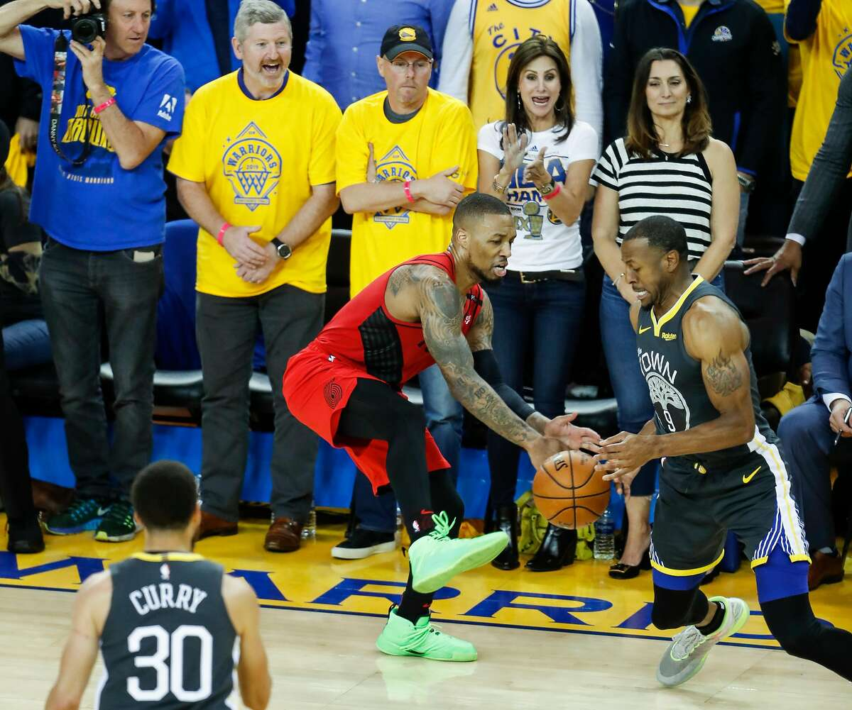 Golden State Warriors' Andre Iguodala steals the ball from Portland Trail Blazers' Damian Lillard in the fourth quarter during game 2 of the Western Conference Finals between the Golden State Warriors and the Portland Trail Blazers at Oracle Arena on Thursday, May 16, 2019 in Oakland, Calif.