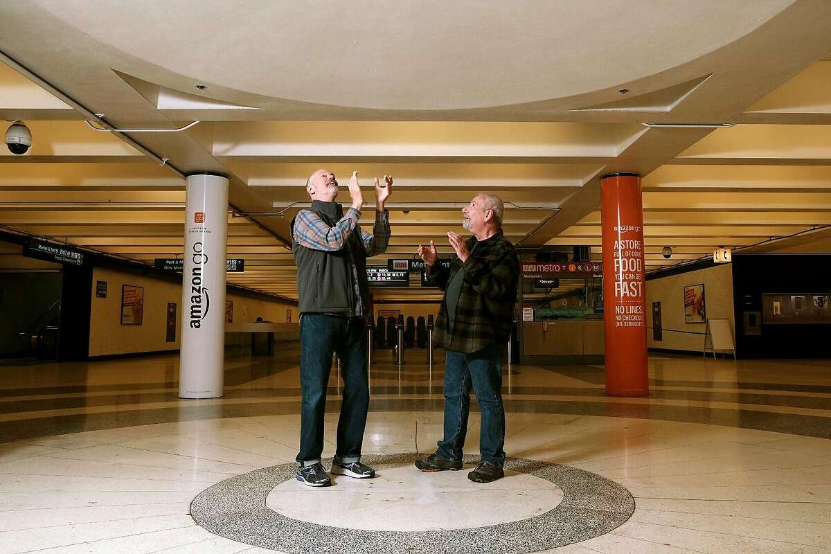 Ken Woods, left, and Tom Kelleher stop and check out a spot in the Montgomery BART station where a newspaper kiosk was removed and that is now a naturally occurring echo chamber, in San Francisco, Calif., Friday May 17, 2019.