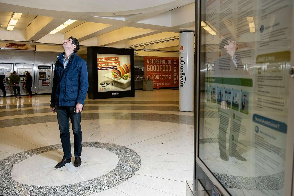 NBC reporter Sam Brock looks up at a spot in the Montgomery BART station where a kiosk was removed and that is now a naturally occurring echo chamber, in San Francisco, Calif, on Friday, May 17, 2019.