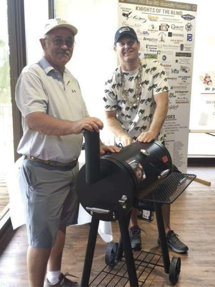 Lions are lining up prizes galore for the Conroe Noon Lions Club -33rd Annual Golf Tournament taking place this coming Thursday at April Sound Country Club. This year's theme is back to the Caddyshack and limited space is available, contact the club office at 936-760-1666. Pictured one of last year's winners: Reggie Coots left and Club President Bobby Brennan right.