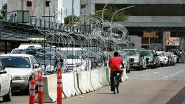 Razor wire attached to traffic barriers have been placed on the international bridge separating Laredo and Nuevo Laredo in anticipation of any migrant problems.