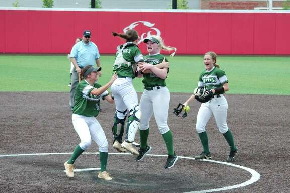 Lutheran South Academy shortstop Anna Jones (14), catcher Lauren Whitney (4), pitcher Shelby Smith (23) and first baseman Ashley Foret (16) celebrate after defeating Fort Bend Christian Friday at Crosby High School.