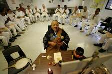 In 2009, a Buddhist monk leads inmates in a Navasota prison during services. Prisoners have religious lives, and death is a religious experience for many facing execution. Chaplains should be allowed in Texas execution chambers if requested.