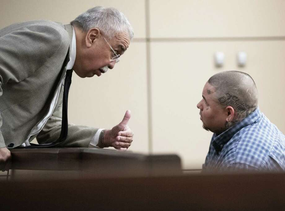Rodney Helms, right, speaks with defense attorney Rolando Garcia in district court Friday. Helms faces up to 20 years in prison if convicted of failure to stop and render aid resulting in death, a second-degree felony. Photo: Carlos Javier Sanchez /Contributor / Carlos Javier Sanchez