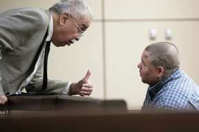 Rodney Helms, right, speaks with defense attorney Rolando Garcia in district court Friday. Helms faces up to 20 years in prison if convicted of failure to stop and render aid resulting in death, a second-degree felony.