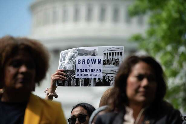 People attend a rally to mark the 65th anniversary of the US Supreme Court's Brown v Board of Education ruling that ended segregation in public schools, near the Capitol in Washington, DC, on May 16.