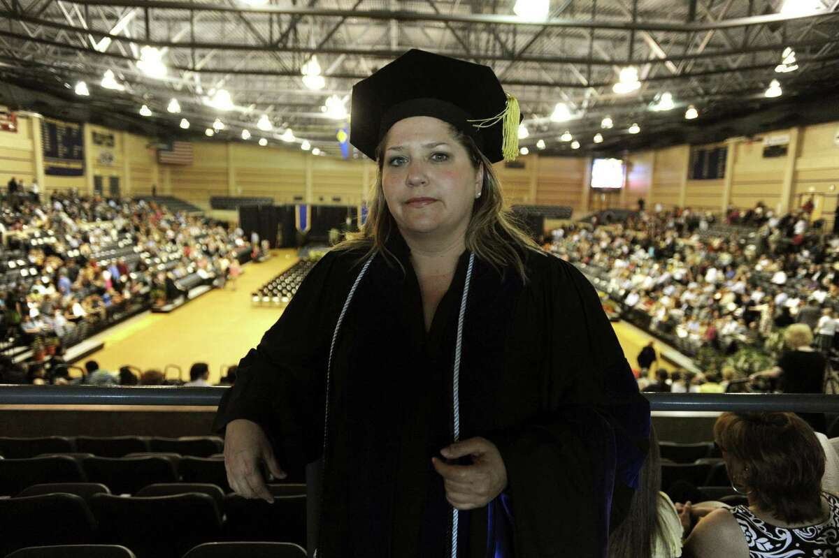When wealthy parents try to buy their childrens' way into prestigious schools, they are teaching certain values to their kids. And then there are the values taught when, after a 17-year nursing career, Gaylynn Griffin, graduates after going through the St. Mary's University night law school program in 2010. She has two children.