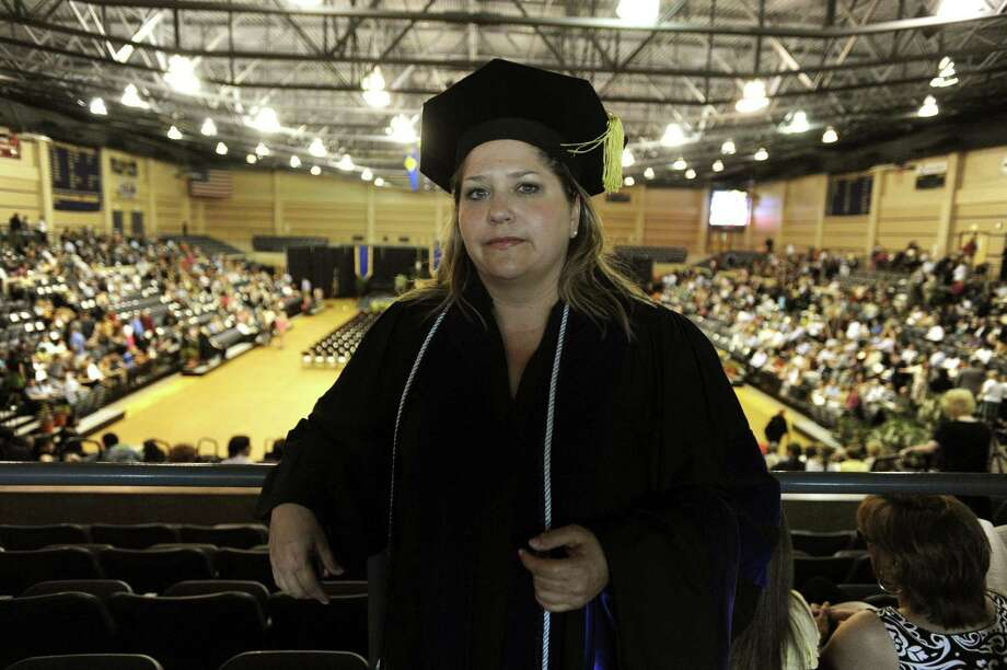 When wealthy parents try to buy their childrens' way into prestigious schools, they are teaching certain values to their kids. And then there are the values taught when, after a 17-year nursing career, Gaylynn Griffin, graduates after going through the St. Mary's University night law school program in 2010. She has two children. Photo: BILLY CALZADA /SAN ANTONIO EXPRESS-NEWS / gcalzada@express-news.net