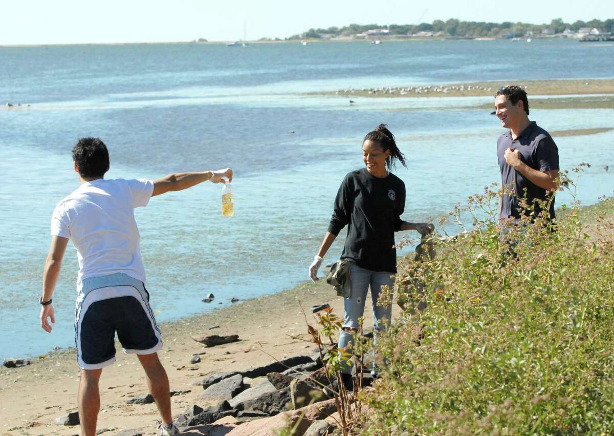 Consumers' increasing concern for and awareness of the environment is spurring more corporate responsibility in this regard from private companies. Here, Yale University students clean up the coastline in Connecticut.