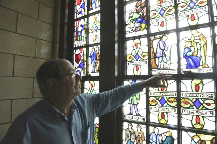 David Lawson, chairman of the Board of Education, points out section of a stained glass window, by Len R. Howard, in the old high school building, now known as the Lillis Administration building. The project was commissioned by the WPA's Federal Arts Program in 1936. New Milford is using a grant to have a consultant study the best way to use the East Street building. Photo: H John Voorhees III / Hearst Connecticut Media / The News-Times