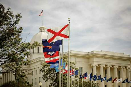 Flags fly outside the Alabama State Capitol, May 8, 2019. Even before the near-total ban that Gov. Kay Ivey signed on May 16, 2019, only three clinics remained in the state. The state is aiming for zero. (Audra Melton/The New York Times)