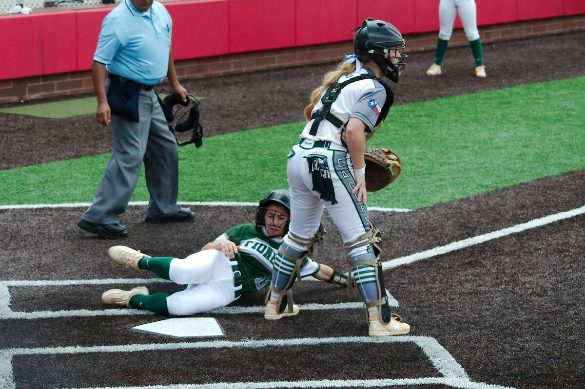 Lutheran South's Grace Lebanc (19) slides safely past Fort Bend Christian's Riley Cargile (9) Friday, May 17 at Crosby High School.