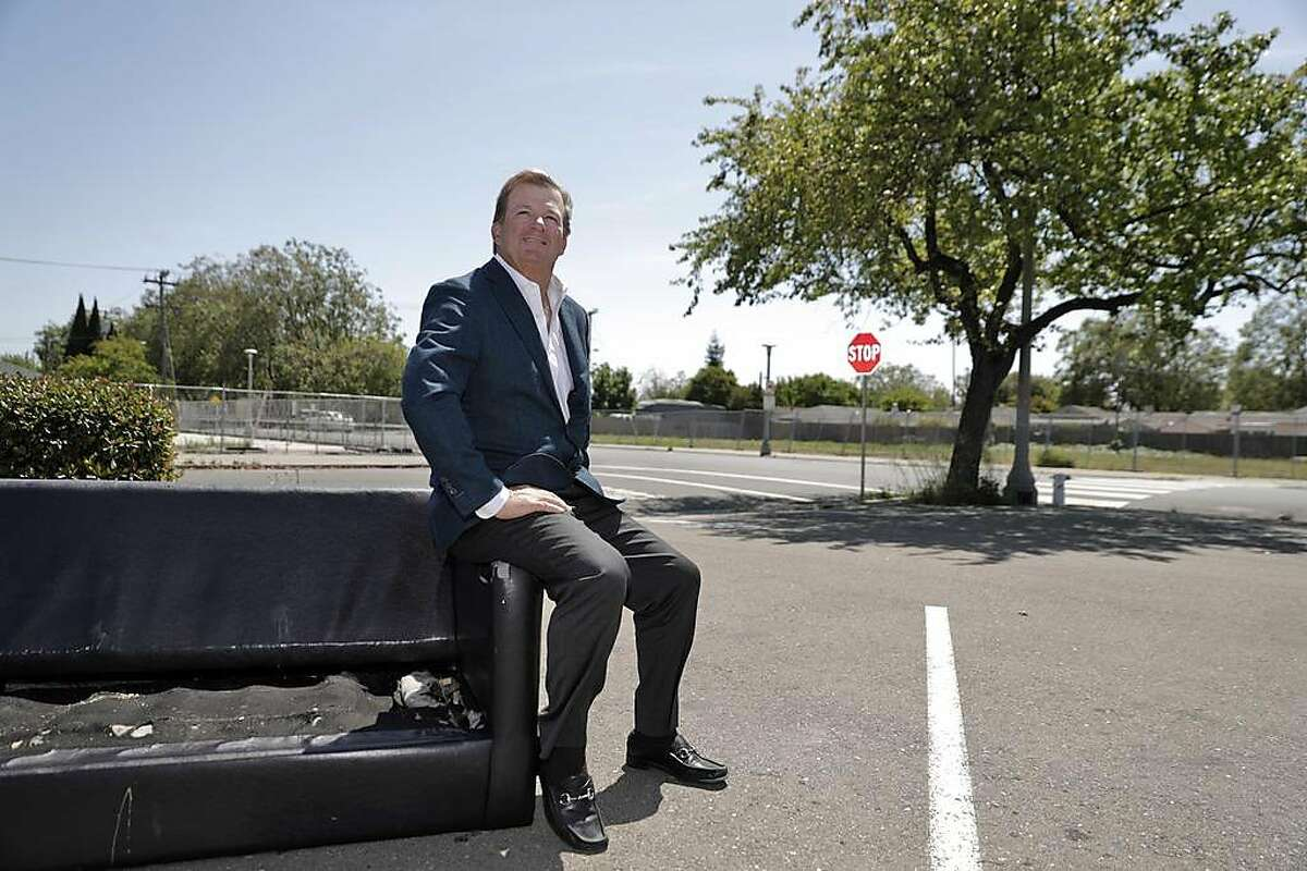 Developer Terry Demmon sits on an abandoned couch at the site where he hopes to build a 163-unit combined housing and retail center in San Lorenzo, Calif., on Tuesday, May 7, 2019. Demmons claims the project is being delayed by unions which he claims are trying to force him to use union labor.
