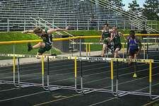 Midland Dow's Garrett Daniels competes in the Mens 110 meter hurdles event at the Division 1 track and field regional held at Bay City Western High School in Bay City on Friday, May 17, 2019. (Josie Norris/for the Daily News)