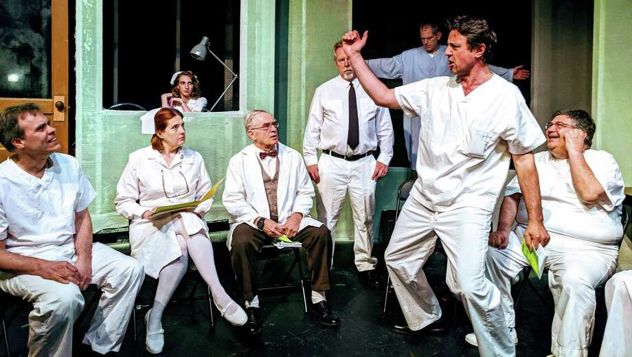 "McMurphy tries to liven up group therapy in ""One Flew Over the Cuckoo's Nest,"" onstage at The Ridgefield Theater Barn, May 31 through June 22. From left are Roger Dykeman, Alicia Dempster, Nicole Neurohr, Robert Molloy, Mark Hankla, Fred Rueck and Stephen Zerilli. Photo: Paulette Layton / Contributed Photo"