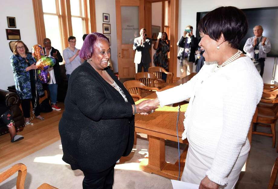 New 8th Ward 8 Alder Brenda Harris, left, is congratulated by New Haven Mayor Toni Harp after being sworn in at City Hall in New Haven on May 17, 2019. Photo: Arnold Gold / Hearst Connecticut Media / New Haven Register