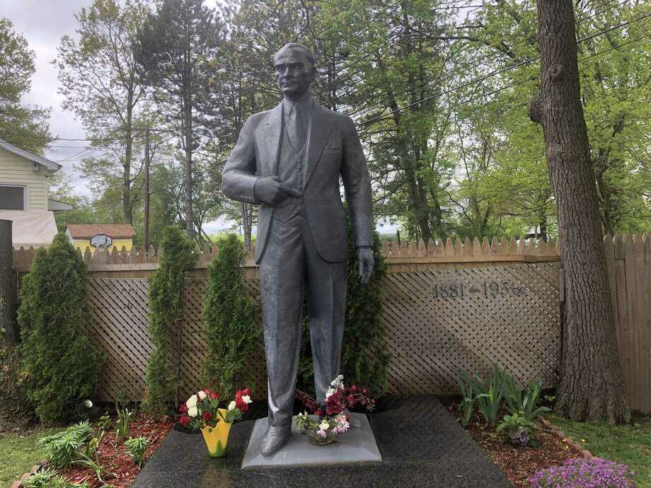 Feray Gokcek has created a shrine to Mustafa Kemal Ataturk, the founder of modern Turkey, in his back yard on Middletown Avenue in New Haven. A statue of Ataturk was erected in 2016. Turkish Americans will celebrate the 100th anniversary of Ataturk's launching of the Turkish War of Independence on Sunday, May 19, 2019. Photo: Ed Stannard / Hearst Connecticut Media