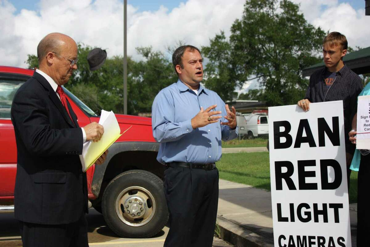 Byrom Schirmbeck, center, a Baytown resident that led efforts to remove the city's red light cameras, also helped the Tri-County Texas Tea Party in Cleveland oppose the cameras.