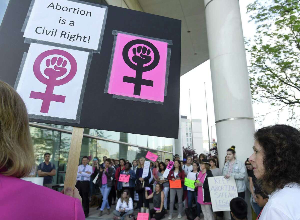 Participants with the We Won't Go Back movement hold a rally outside the Stamford Government Center on May 17, 2019 in Stamford, Connecticut. Over 100 participants stood in solidarity protesting the recent anti-abortion decisions and changes in law in other states.
