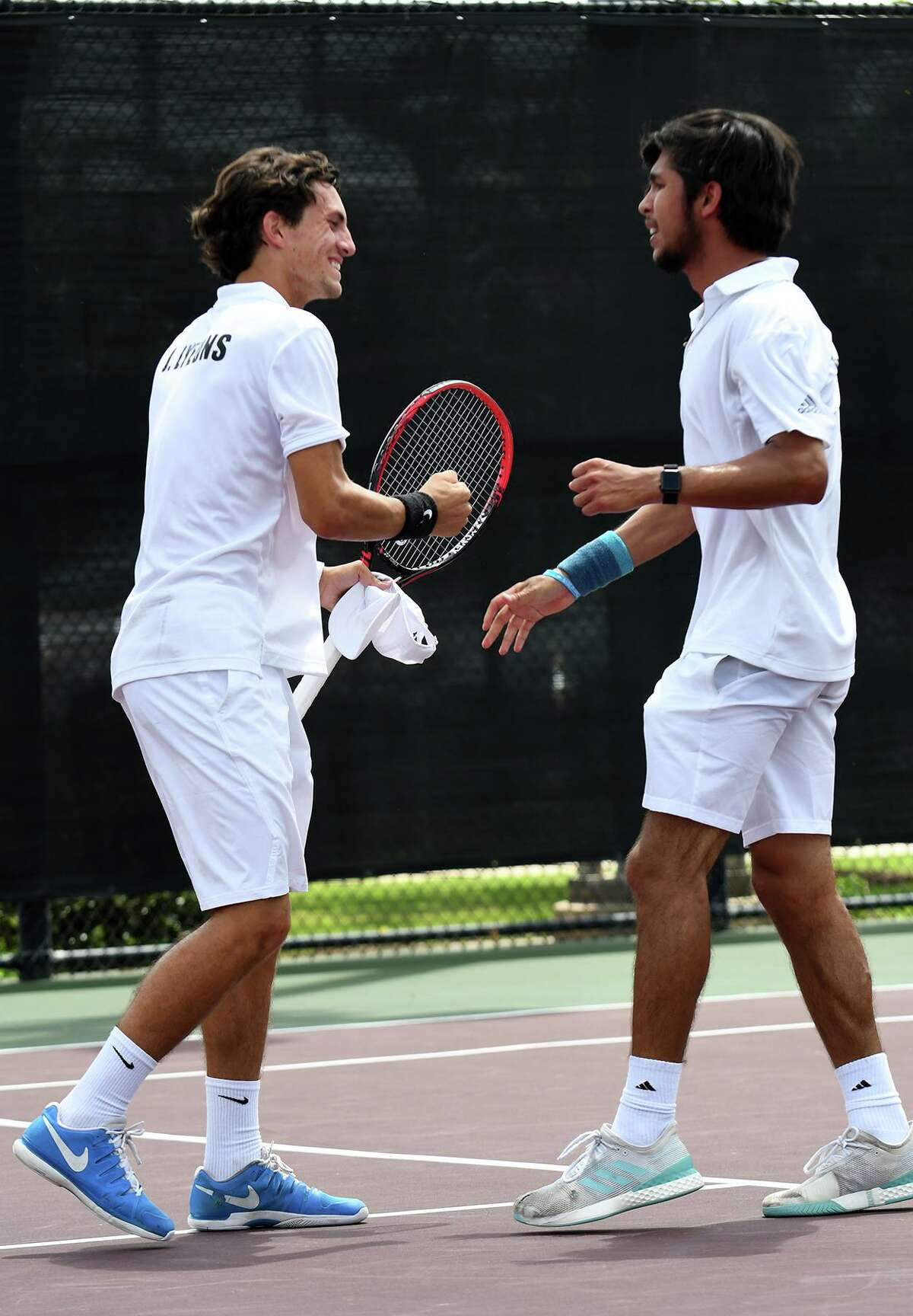 Clements' Jaycer Lyeons, left, and David Peters celebrate after closing out their Class 6A Boys Doubles State Tennis Championship over Houston Memorial's Cole Radner and Drew Shuvalov at the George P. Mitchell Tennis Center on the campus of Texas A&M University in College Station on May 17, 2019.
