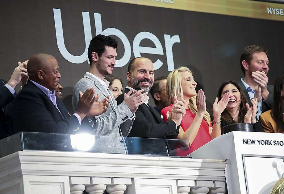 Uber Technologies Inc. CEO Dara Khosrowshahi (third from left, front row) and invited guests ring the opening bell at the New York Stock Exchange in New York on Friday, May 10, 2019. U.S. ride hailing company Uber Technologies Inc. began trading on the NYSE on Friday. (Xinhua/Zuma Press/TNS) Photo: Xinhua, TNS
