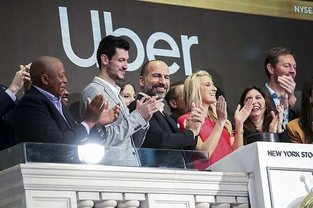 Uber Technologies Inc. CEO Dara Khosrowshahi (third from left, front row) and invited guests ring the opening bell at the New York Stock Exchange in New York on Friday, May 10, 2019. U.S. ride hailing company Uber Technologies Inc. began trading on the NYSE on Friday. (Xinhua/Zuma Press/TNS)