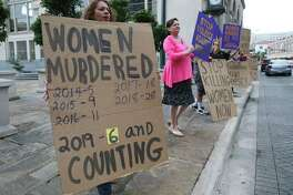 Ellie De La Cruz, left, e joins a rally near City Hall on May 1 to call attention to domestic violence accusations against mayoral hopeful Greg Brockhouse. A cynic would say Brockhouse and San Antonio are a perfect match.