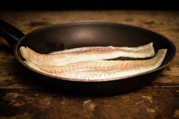 Fry up snapper or bass in a skillet for this Astros-inspired recipe.