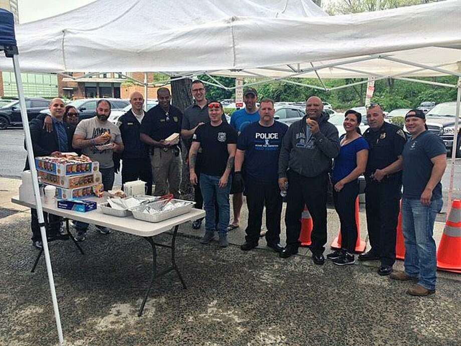 Members of the New Haven, Conn., police force pose for a photo during an appreciation breakfast and lunch at police headquarters on May 17, 2019. Photo: Contributed Photo