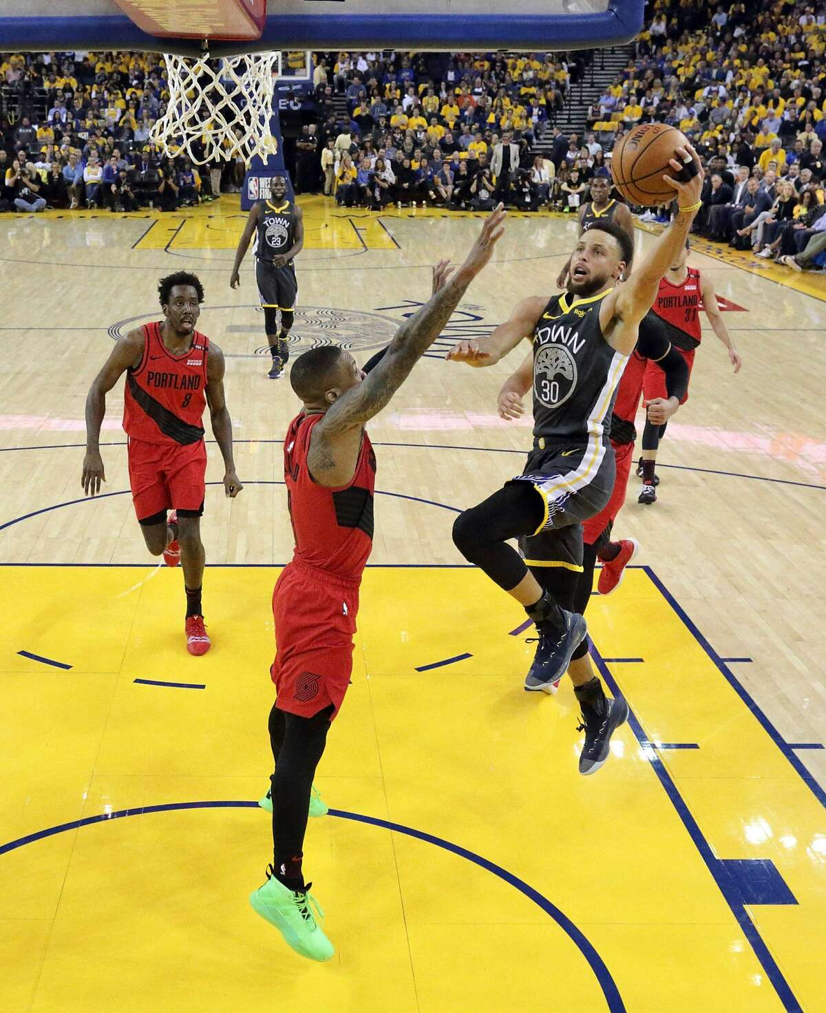 Stephen Curry (30) drives to the basket in the first half as the Golden State Warriors played the Portland Trailblazers in Game 2 of the Western Conference Finals at Oracle Arena in Oakland, Calif., on Thursday, May 16, 2019. After losing his ID bracelet at the game, writer Alex Tourk learned the team are champions in customer service, too.