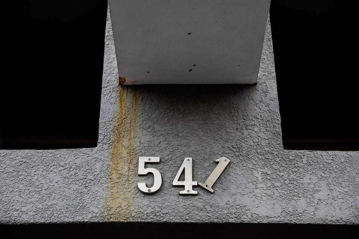 The numbers on an address at an empty storefront are seen broken on Castro Street in San Francisco, California, on Monday, Oct. 29, 2018.