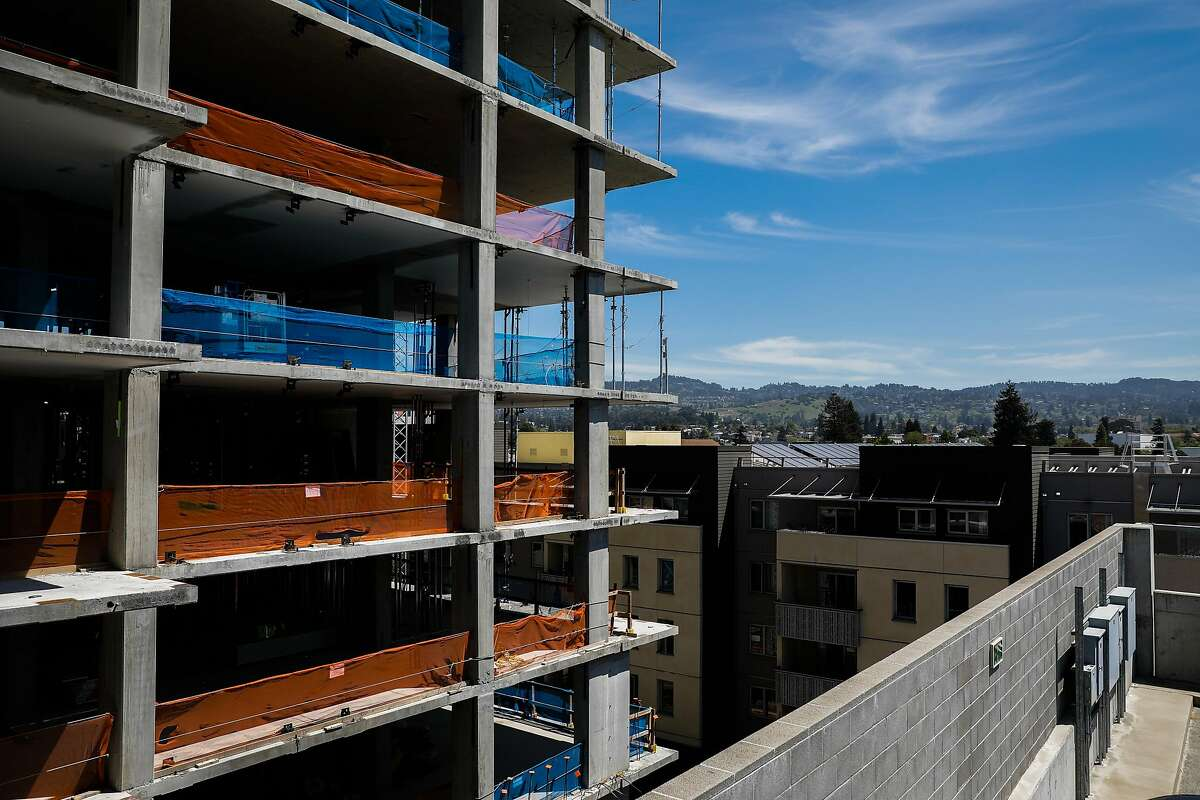 An apartment building is seen under construction near the MacArthur BART station in Oakland, California, on Tuesday, April 23, 2019.