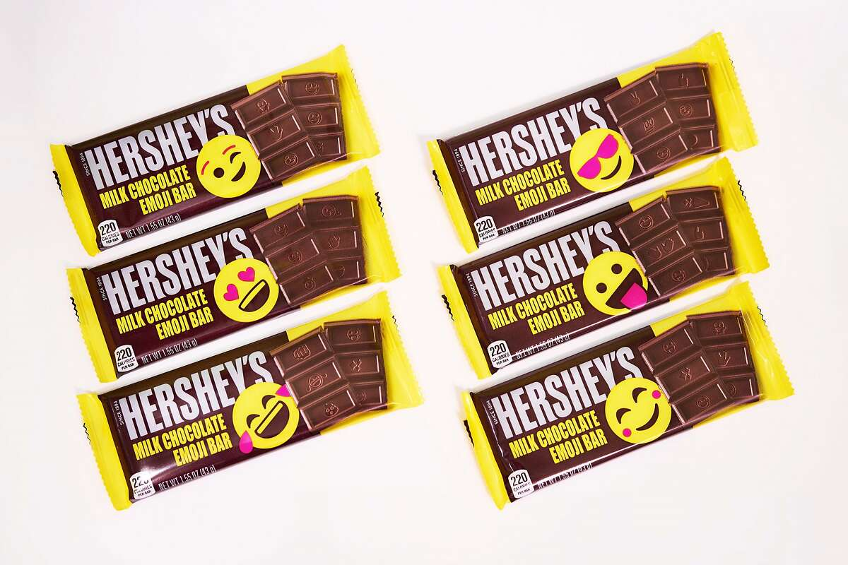 A new chocolate bar from Hershey's replaces the familiar logo with emoji characters.