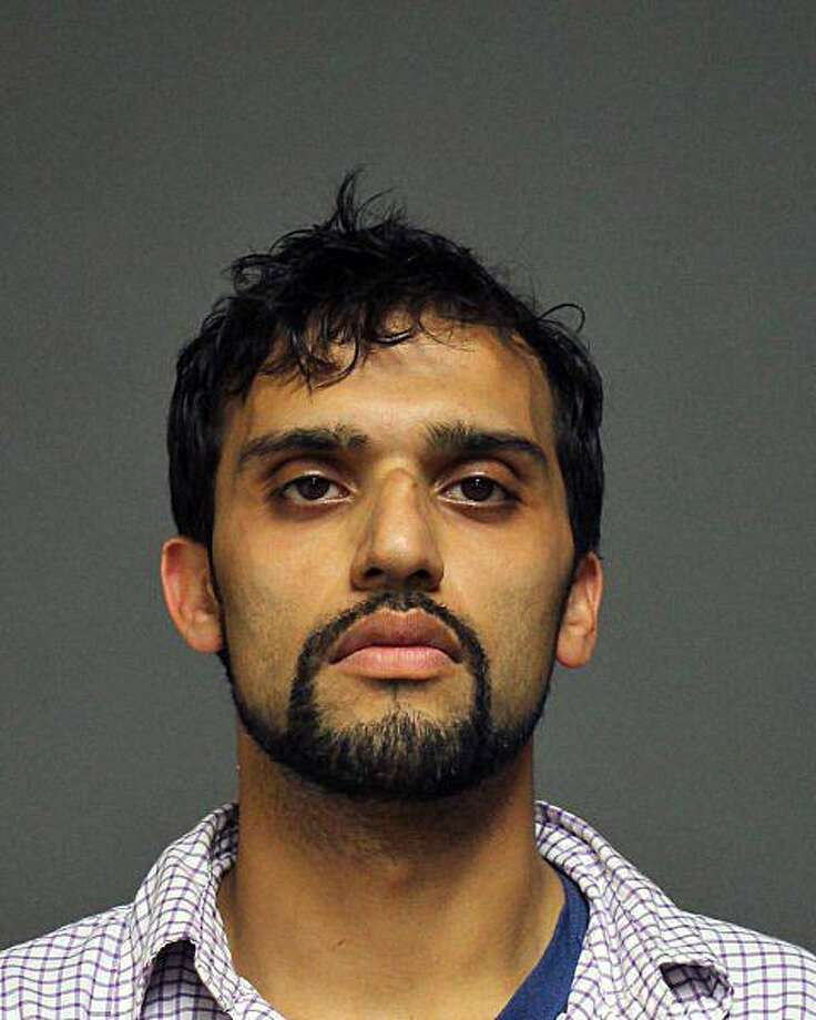 Nirav Patel, 29, of New Britain, was charged with second-degree robbery, fourth-degree larceny, first-degree reckless endangerment, evading responsibility of an accident, engaging police in a pursuit, reckless driving and failure to obey a traffic signal. Photo: Contributed Photo / Fairfield Police Department