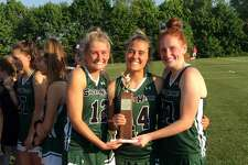 From left to right, captains Hilary Hoover, Ryan Smith and Athena Corroon hold the trophy after Sacred Heart Greenwich posted a 13-1 victory over Greens Farms Academy in the championship game of the FAA Girls Lacrosse Tournament on May 17, 2019, in Greenwich.
