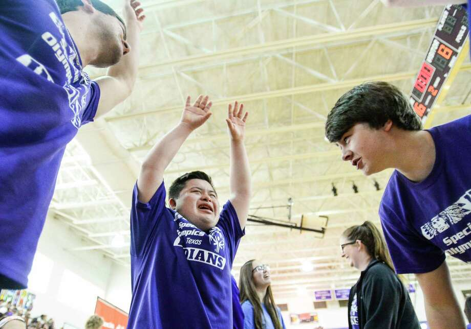 PN-G's Special Olympian Aaron Gonzales leads a huddle break cheer during the Special Olympics basketball tournament in Port Neches-Groves' gym Friday. Photo taken on Friday, 05/17/19. Ryan Welch/The Enterprise Photo: Ryan Welch, The Enterprise / © 2019 Beaumont Enterprise
