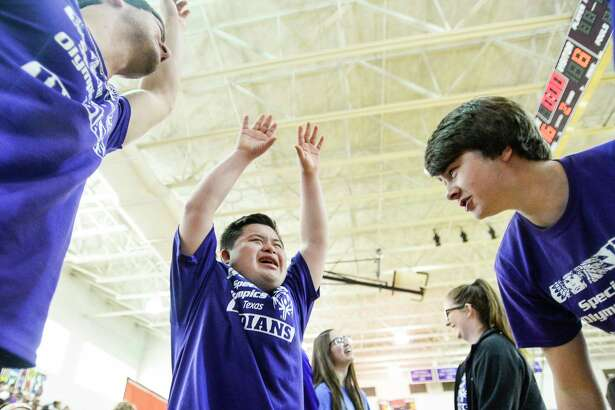 PN-G's Special Olympian Aaron Gonzales leads a huddle break cheer during the Special Olympics basketball tournament in Port Neches-Groves' gym Friday. Photo taken on Friday, 05/17/19. Ryan Welch/The Enterprise