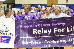 People raising awareness and money for cancer research at the 2019 Huron County Relay For Life in Bad Axe Middle School Gymnasium.