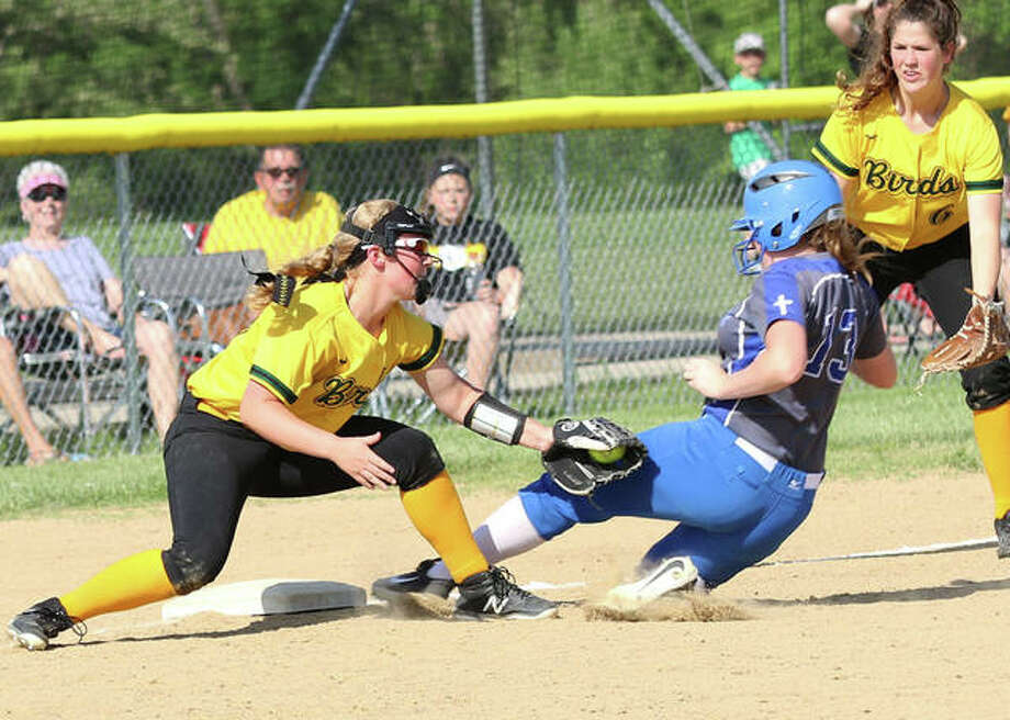 Southwestern third baseman Bri Roloff (left) tags out Marquette Catholic's Allene Brass at third while Piasa Birds left fielder Bailee Sorgea backs up the play during the fourth inning Friday in the championship game of the Southwestern Class 2A Regional in Piasa. Photo: Greg Shashack / The Telegraph