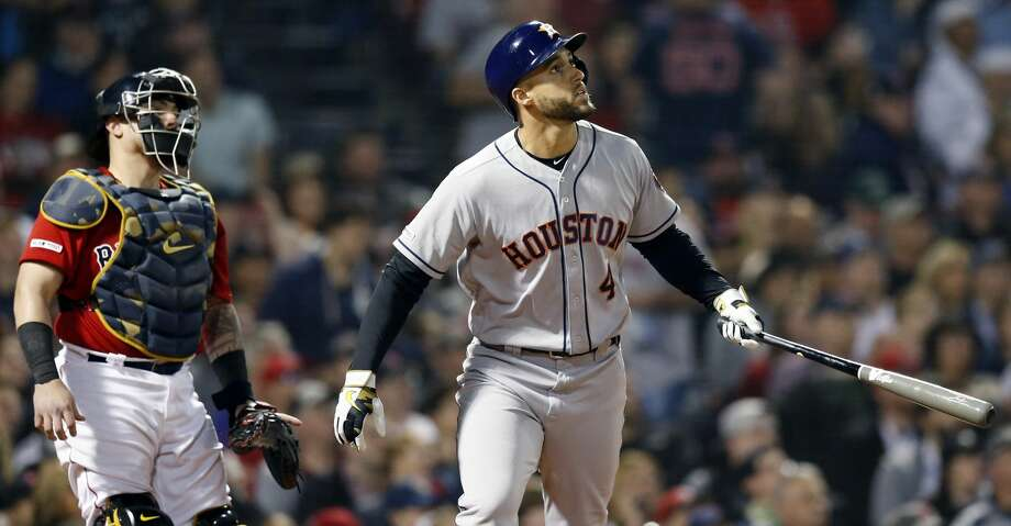 Houston Astros' George Springer (4) watches his two-run home run in front of Boston Red Sox's Christian Vazquez during the eighth inning of a baseball game in Boston, Friday, May 17, 2019. (AP Photo/Michael Dwyer) Photo: Michael Dwyer/Associated Press